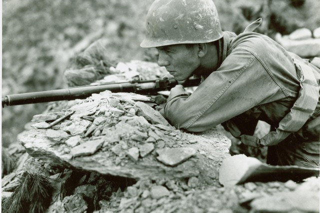 American soldier scans the area in front of his Observation Post on the front line somewhere in Korea. July 29th, 1950.