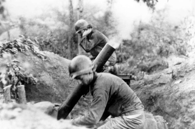 An American mortar crew fires on the Communist North Korean invaders near Chochiwan, Korea, 11 July 1950.
