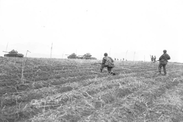 Men of the 3rd U.S. Rangers, 3rd Infantry Division, advance north of the Imjim River across the 38th Parallel in Korea, while under heavy mortar fire from the Chinese Communists, April 11, 1951.