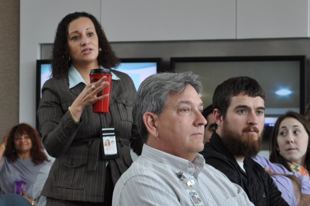 Monica Webb, G4 facilities manager, responds to a question during the SHARP production performed at the ATEC Headquarters on Aberdeen Proving Ground April 23-24, 2013.