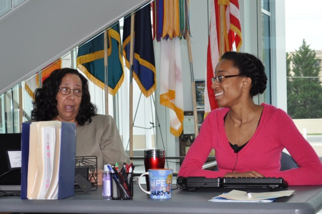 Michele Davis, G6 information technology specialist, and Shiara Penn, G8 budget analyst, make sexually suggestive comments about a male co-worker during an ATEC SHARP Production at the Hollis Building on Aberdeen Proving Ground April 23-24, 2013.
