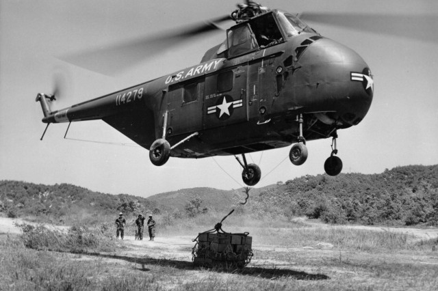 A helicopter of the 6th Transportation Helicopter Company, U.S. Eighth Army, delivers C-rations to the 25th U.S. Infantry Division's 35th Infantry Regiment, near Panmunjom, Korea, May 23, 1953.