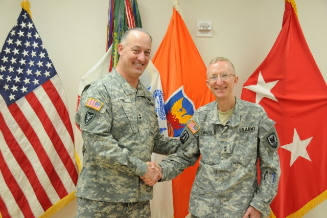 Maj. Gen. Alan R. Lynn, NETCOM Commanding General meets with Maj. Gen. James T. Walton, 311th Signal Command (Theater) Commanding General and U.S. Army Pacific G6 at the 311th SC (T) headquarters on Fort Shafter, Hawaii.