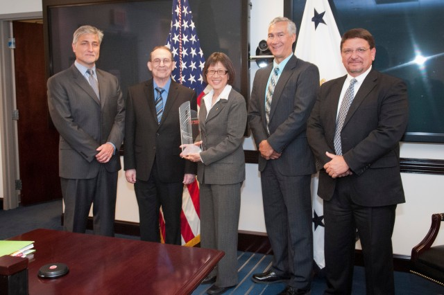 The U.S. Army has been named one of the 2012 Top100 Global Innovators by Thomson Reuters, the multimedia and information conglomerate. Pictured with the award are Bob Barbour, senior vice president, Global Sales for IP Solutions; Thomson Reuters, Ronald E. Meyers of the Army Research Laboratory; Heidi Shyu, assistant secretary of the Army for Acquisition, Logistics and Technology; John E. Nettleton of the Communications-Electronics Research, Development and Engineering Center; and Bartley Durst of the Engineer Research and Development Center (Corps of Engineers).