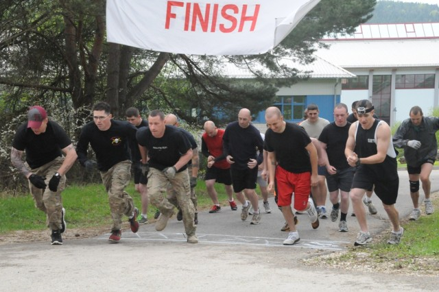Competitors sprint from the starting line as Hohenfels' Warrior Challenge gets under way, May 4.