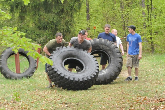 Teams take turns flipping tremendous tires during the Hohenfels Warrior Challenge, May 4.