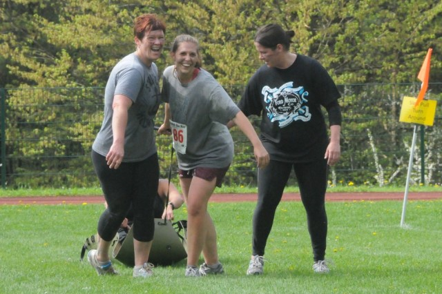 Team B.A.B., the only all-female team competing in Hohenfels' Warrior challenge, laugh all the way to the finish line during the sled pull.