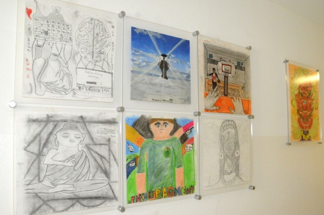 HMHS art students create works that showcase the five dimensions of physical, emotional, social, family and spiritual health for display in the Hohenfels Health Clinic.
