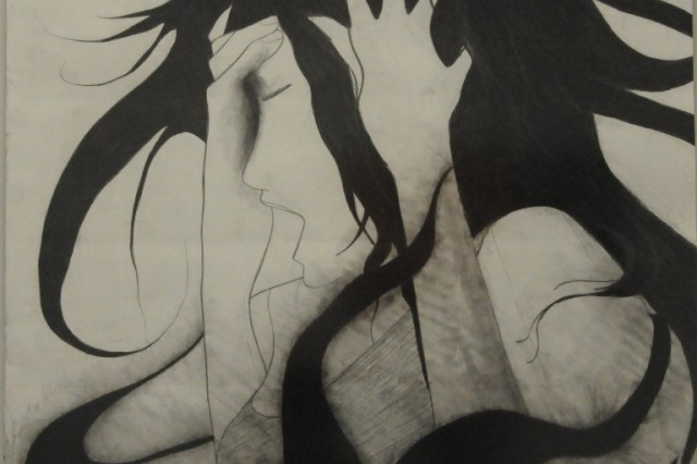 Sophomore Lilian Lucero's charcoal drawing reflects the stress people can feel on a daily basis.