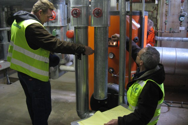 A project team inspects mechanical systems at Sembach Kaserne near Kaiserslautern, Germany, during a energy audit managed by the U.S. Army Corps of Engineers Europe District. The U.S. Army Garrison Kaiserslautern installation audit was conducted for an energy master planning project aimed at achieving net-zero energy status by 2025.
