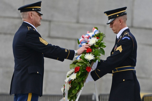 Sgt. Maj. of the Army Raymond F. Chandler III lays a wreath at the Victory in Europe Day event at the World War II Memorial in Washington, D.C., May 8, 2013.