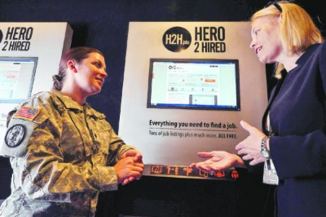 Employment counselor Sandy Williams assists Spc. Katy Eyler in the Hero 2 Hired trailer during Friday's Transition Check Point at McGill Training Center. Hero 2 Hired provides job search advice for transitioning service members.
