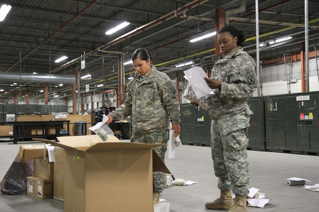 Spc. Lucille White, left, and Spc. Shannon Green sort through supplies that came in multipack boxes to ensure items and quantities match the paperwork. Once processed through the receiving section, items are sent to their prospective sections