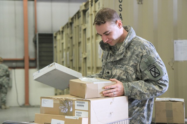 Spc. Lawrence Daniels sorts through several items to find out what storage location to which they will be placed.