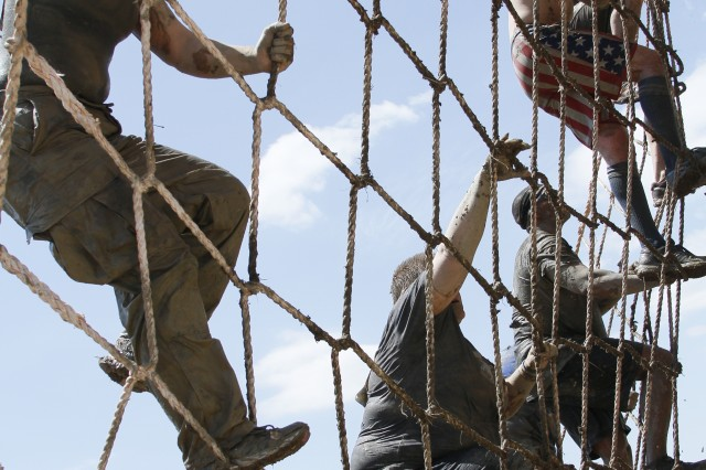 FORT CARSON, Colo. -- Racers climb the cargo bridge during the Colorado Military Spartan Race on Fort Carson, May 4. More than 10,000 people registered to take on the 4.5-mile course featuring 28 obstacles at Iron Horse Park during the weekend.