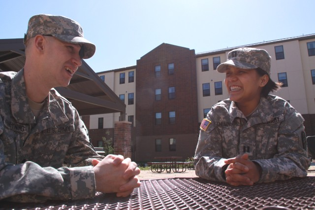 Capt. Sochara Chumnoeur, a nurse case manager, speaks with Spc. Aaron Vanhyning on April 22 at Madigan Army Medical Center's Warrior Transition Battalion at Joint Base Lewis-McChord, Wash. (Photo by Spc. Jazz Burney)