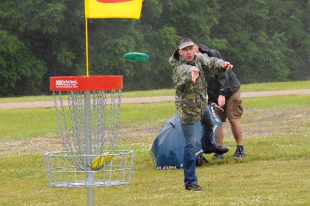 W01 Joseph Obenschain, throws a disc at the first hole during Fort Rucker's first Flying Disc Golf Tournament at Beaver Lake May 4.