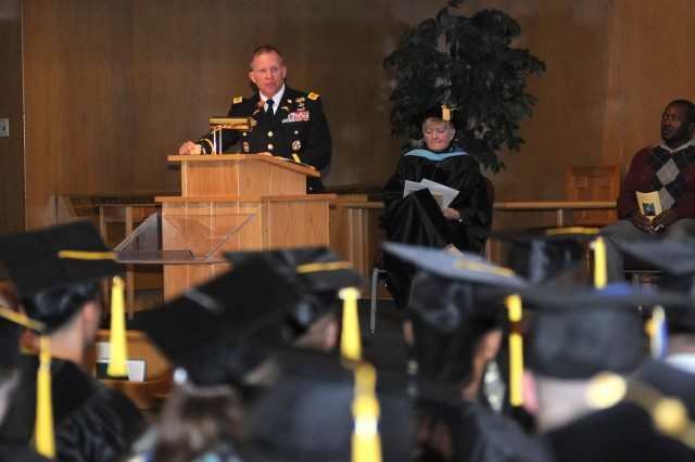 """U.S. Army Alaska Deputy Commander Col. Mark Freitag gave the commencement address to more than 30 graduating students and their Families at the 2013 Joint College Commencement event on Fort Wainwright May 6.  """"For those of you graduating, consider how you can serve your fellow man,"""" Freitag said. """"There are numerous needs out there and never enough resources. Challenge yourself and make the most of your new degree in this great land of opportunity."""""""