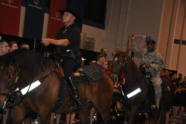 Brig. General Bryan Roberts, right, Fort Jackson commanding general, enters the Solomon Center on horseback during Friday's opening ceremonies. The event brought an estimated 1,200 athletes to post last weekend.