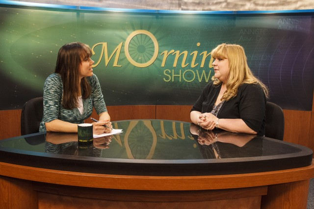 Michelle Bain, right, shares her story of skin cancer survival with the Anniston Army Depot workforce on the April 24 Morning Show during an interview with co-host Lori Thomas.
