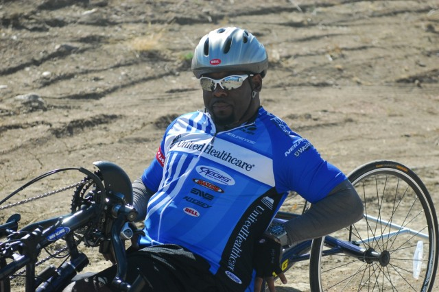 Fort Carson, CO - Sgt. 1st Class (Retired) Charles Armstead from Needville, Texas, takes a lap during a cycling practice in preparation for the 2013 Warrior Games, May 7, 2013.  It will be Armstead's first year participating in the games.  He hopes to take home a medal in cycling, sitting volleyball, or wheelchair basketball.  Since 2010, the Warrior Games have brought together wounded, ill or injured service members to compete in a goodwill competition. This year, the Warrior Games will include wounded warriors from the Army, Marine Corps, Navy, Coast Guard, Air Force, Special Operations Command and the United Kingdom. (U.S. Army photo by 1st Lt Yves-Marie Daley, 210th Mobile Public Affairs Detachment)