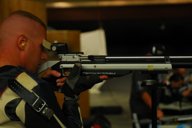 """Fort Carson, CO """" Staff Sgt. David Lee Carte from the Warrior Transition Battalion, Fort Bliss, Texas, lines up a shot during rifle practice in preparation for the 2013 Warrior Games, May 7, 2013. Carte says he was incredibly excited when he heard he had been selected to participate in the games. The Hollister, California native sustained a back injury while on assignment in Iraq in 2006.  Since 2010, the Warrior Games have brought together wounded, ill or injured service members to compete in a goodwill competition. This year, the Warrior Games will include wounded warriors from the Army, Marine Corps, Navy, Coast Guard, Air Force, Special Operations Command and the United Kingdom. (U.S. Army photo by 1st Lt Yves-Marie Daley, 210th Mobile Public Affairs Detachment)"""