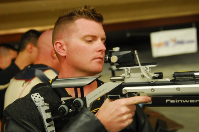 "Fort Carson, CO "" Staff Sgt. Nathan Robbins with the Warrior Transition Unit at Fort Bliss, Texas, inspects his rifle during rifle practice in preparation for the 2013 Warrior Games, May 7, 2013. Robbins hopes to win an individual award for shooting as well as help Team Army win the Commander's Cup. The San Francisco native sustained serious lower back and left knee injuries as well as a traumatic brain injury during his deployment to Afghanistan in 2011.  Since 2010, the Warrior Games have brought together wounded, ill or injured service members to compete in a goodwill competition. This year, the Warrior Games will include wounded warriors from the Army, Marine Corps, Navy, Coast Guard, Air Force, Special Operations Command and the United Kingdom. (U.S. Army photo by 1st Lt Yves-Marie Daley, 210th Mobile Public Affairs Detachment)"