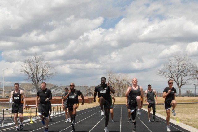 "Fort Carson, CO "" U.S. Army Soldiers train during track and field practice May 7, 2013 in preparation for the 2013 Warrior Games. Since 2010, the Warrior Games have brought together wounded, ill or injured service members to compete in a goodwill competition. This year, the Warrior Games will include wounded warriors from the Army, Marine Corps, Navy, Coast Guard, Air Force, Special Operations Command and the United Kingdom. (U.S. Army photo by 1st Lt Yves-Marie Daley, 210th Mobile Public Affairs Detachment)"