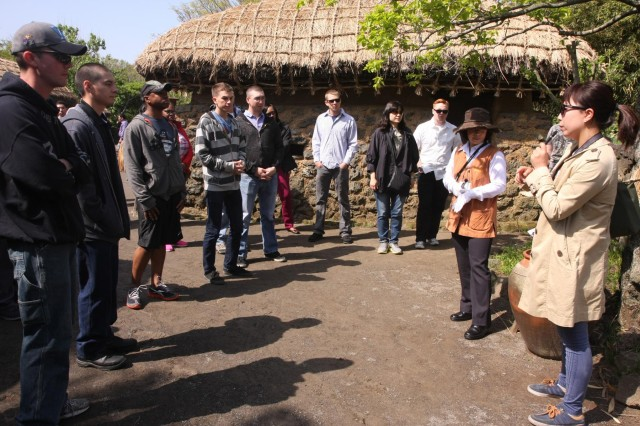 Soldiers of the 2nd Infantry Divsion enjoy a tour of a restored 1800s era village on Jeju Island.