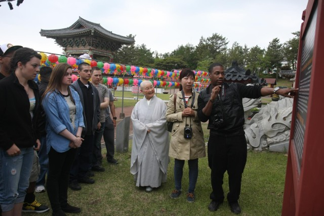 Soldiers of the 2nd Infantry Division enjoy a history lesson at a Buddhist temple on Jeju Island.