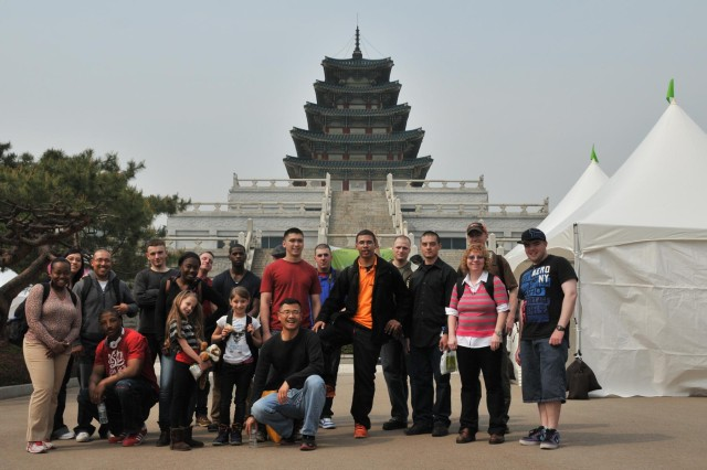 Soldiers and Family members take a group photo at the end of a tour of Gyeongbokgung Palace, May 3, 2013.