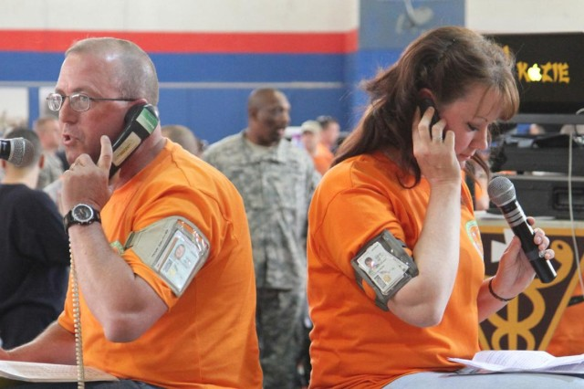 Master Sgt. Michael Martin and Maj. Christina Dean, 38th Sustainment Brigade resiliency Soldiers, perform a skit about communication during a resiliency expo at Camp Arifjan, Kuwait, April 6, 2013. The skit outlined how the lives at home and abroad are handled and addressed through communication.