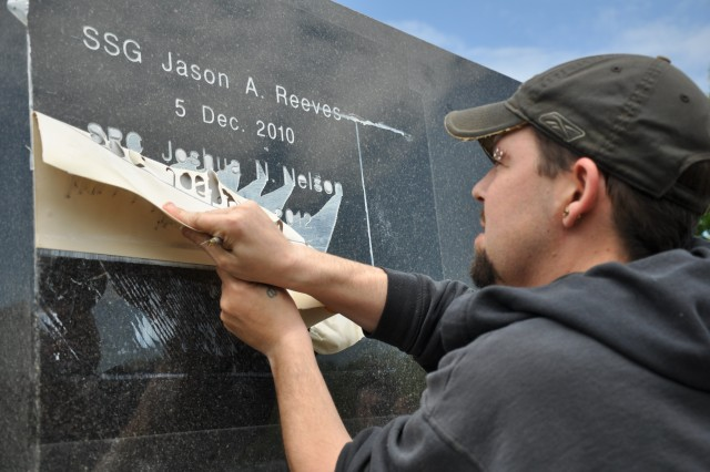 The name of Spc. Joshua N. Nelson, a fallen hero formerly with U.S. Army Intelligence and Security Command (INSCOM), is engraved into the black marble INSCOM Memorial at Fort Belvoir, Va., May 9. Nelson, a Greenville, N.C. native, lost his life Sept. 16, 2012 in the Afghanistan province of Zabul, in support of the 513th Military Intelligence Brigade and INSCOM and Operation Enduring Freedom. (U.S. Army photo by Sgt. Jesus J. Aranda, U.S. Army Intelligence and Security Command Public Affairs)