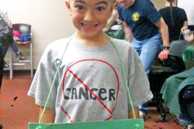 Andrew Mortimer, 7, Junction City, participates in a head-shaving event for the Saint Baldrick's Foundation April 27 at the Warrior Zone, Fort Riley, Kan. His younger brother, Brady, died from a rare childhood cancer.