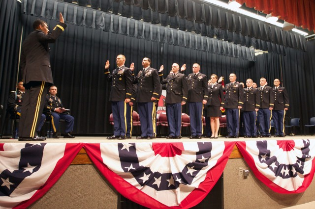 Lt. Gen. Vincent Brooks administers the oath of office to University of Louisville Cadets Friday at Strickler Hall on campus. Photo by Steve Arel/U.S. Army Cadet Command
