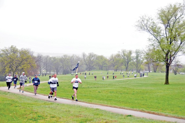 Runners approach the finish line during the Run for the Fallen May 4 at Riley's Conference Center, Fort Riley, Kan. More than 430 runners came out to participate in the Run for the Fallen event at Fort Riley.