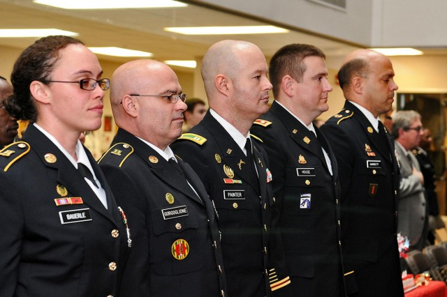 From left, Staff Sgt. Kenita Bauerle, 822nd Military Police Company; 1st Sgt. David Gorgoglione, 814th MP Company; Capt. Ronald Painter, 327th MP Battalion; Lt. Col. Jason House, 3rd Brigade, 75th Training Command; and Master Sgt. Gilbert Garrett, 85th Support Command, stand for the arrival of the official party of the event. Each soldier was a guest speaker sharing their individual unit's lineage during the 105th birthday celebration of the U.S. Army Reserve.
