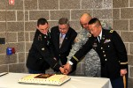 Oldest and youngest with Army Reserve ambassador cut Fort McCoy's cake