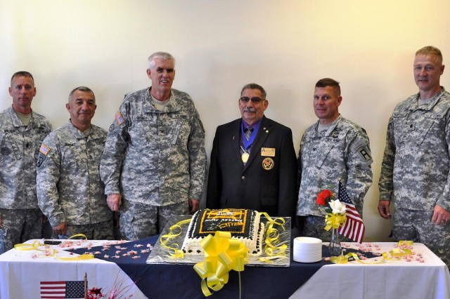 From the left: Command Sgt. Maj. Steven Walker, 2207th Mobilization Support Battalion; Sgt. Maj. Gabriel R. Jimenez, Directorate of Mobilization and Deployment sergeant major; Col. John F. Dorney, DoMaD director; retired Army Reserve Col. Robert Cortez, Army Reserve ambassador for New Mexico; Col. Eric Schact, 5th Armored Brigade commander; and Lt. Col. Todd Kurtzhals, 2207th MSB commander, celebrate the Army Reserve's 105th Birthday at McGregor Range Base Camp, N.M.