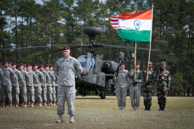 U.S. Army Maj. Steven Wallace, a cavalry officer with the 82nd Airborne Division's 1st Brigade Combat Team, stands before a coalition color guard of American paratroopers and Indian soldiers with the 99th Mountain Brigade at the opening ceremony of Yudh Abhyas 2013, a United Nations mandated training exercise sponsored by U.S. Army Pacific, May 3, 2013, at Fort Bragg, N.C.  This year's exercise marked the first participation of the division.  (U.S. Army photo by Sgt. Michael J. MacLeod)
