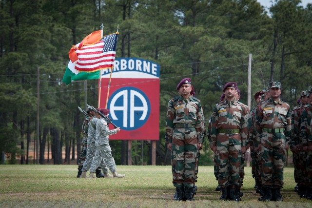 A coalition color guard marches off the 82nd Airborne Division parade ground to conclude the opening ceremony of Yudh Abhyas, the annual training event between the U.S. and Indian armies, May 3, 2013, at Fort Bragg, N.C.  Yudh Abhyas 2013 paired the 82nd Airborne Division's 1st Brigade Combat Team with the Indian army's 99th Mountain Brigade.  (U.S. Army photo by Sgt. Michael J. MacLeod)