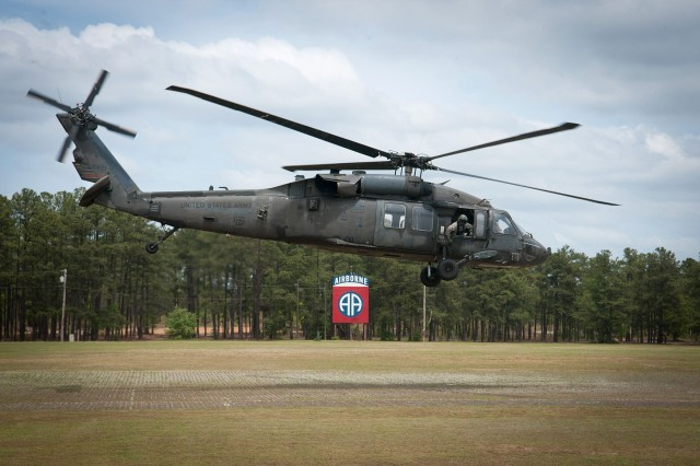 A UH60 Black Hawk helicopter operated by the 82nd Airborne Division Combat Aviation Brgiade takes off from the 82nd Airborne Division parade ground following a reconnaissance of the Yudh Abhyas 2013 training area by U.S. and Indian Army leaders May 3, 2013, at Fort Bragg, N.C.  Sponsored by United States Army Pacific, the exercise has grown every year since its inception.  (U.S. Army photo by Sgt. Michael J. MacLeod)