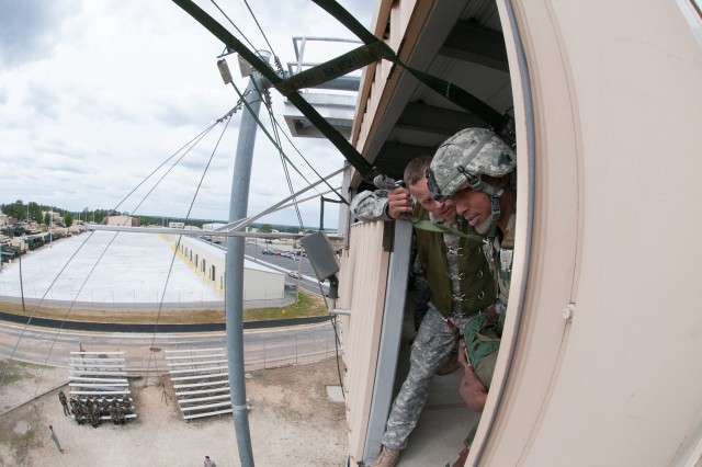 A jumpmaster with the 82nd Airborne Division's Advanced Airborne School readies an Indian Army paratrooper with the 50th Independent Para Brigade to exit a 34-foot parachute training tower May 3, 2013, at Fort Bragg, N.C.  Indian paratroopers are visiting Fort Bragg to participate in Yudh Abhyas, an annual training exercise sponsored by United States Army Pacific between the armies of the U.S. and India.  (U.S. Army photo by Sgt. Michael J. MacLeod)