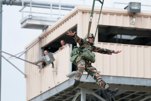 An Indian Army paratrooper with the 50th Independent Para Brigade exits a 34-foot training tower at the 82nd Airborne Division's Advanced Airborne School May 3, 2013, at Fort Bragg, N.C.   Indian paratroopers are visiting Fort Bragg to participate in Yudh Abhyas, an annual training exercise sponsored by United States Army Pacific between the armies of the U.S. and India.  (U.S. Army photo by Sgt. Michael J. MacLeod)