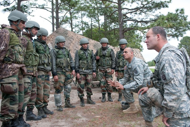 Sgt. Balkrishna Dave, an India-born U.S. Army paratrooper assigned to the John F. Kennedy Special Warfare Center and School, explains weapons-range safety procedures to Indian Army soldiers with the 99th Mountain Brigade before they fire American machine guns May 4, 2013, at Fort Bragg, N.C.  They are part of Yudh Abhyas 2013, the latest annual training event between the armies of India and the United States, sponsored by U.S. Army Pacific.  (U.S. Army photo by Sgt. Michael J. MacLeod)