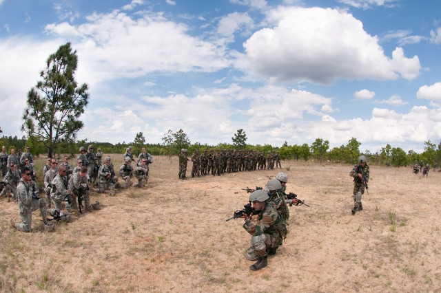 Indian Army soldiers with the 99th Mountain Brigade's 2nd Battalion, 5th Gurkha Rifles, move into position while demonstrating a platoon-level ambush to paratroopers with the U.S. Army's 1st Brigade Combat Team, 82nd Airborne Division, May 7, 2013, at Fort Bragg, N.C.  The soldiers are part of Yudh Abhyas, an annual bilateral training event between the armies of the United States and India, sponsored by U.S. Army Pacific.  (U.S. Army photo by Sgt. Michael J. MacLeod)