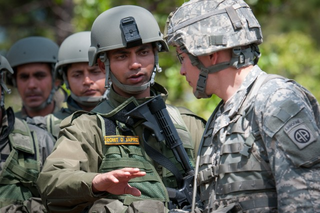 Indian Army Capt. Rohit Sapre, a soldier with the 99th Mountain Brigade, discusses tactics for searching weapons caches with U.S. Army Sgt. Micheal Mark, a combat engineer with the 82nd Airborne Division's 1st Brigade Combat Team May 8, 2013, at Fort Bragg, N.C.  The soldiers were participating in Yudh Abhyas, an annual training event between the Indian Army and United States Army Pacific to improve the ability of the forces involved to respond to a wide range of contingencies.  (U.S. Army photo by Sgt. Michael J. MacLeod)