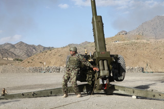"An Afghan National Army soldier assigned to the 2nd Brigade, 203rd ""Thunder"" Corps Artillery Tolei, fires a 122-mm D-30 howitzer at Shey Khan, Paktika Province, Afghanistan, April 29, 2013. Two D-30s were placed in the Pir Kowti Valley during Operation Pamier.  (U.S. Army photo by Spc. Raymond Schaeffer)"