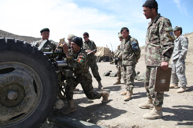 """Afghan National Army soldiers assigned to the 2nd Brigade, 203rd """"Thunder"""" Corps Artillery Tolei, adjust the sights on their 122mm D-30 howitzer at Shey Khan, Paktika Province, Afghanistan, April 28, 2013. Two D-30s were placed in the Pir Kowti Valley during Operation Pamier. (U.S. Army photo by Spc. Raymond Schaeffer)"""