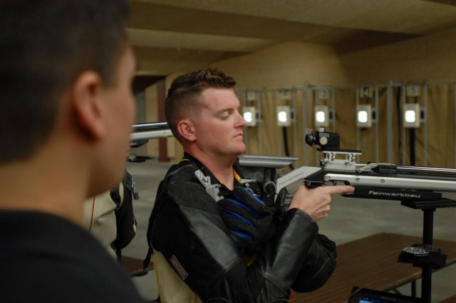 Staff Sgt. Nathan Robbins inspects his rifle during rifle practice in preparation for the 2013 Warrior Games, May 7, 2013. Robbins hopes to win an individual award for shooting as well as help Team Army win the Commander's Cup. The San Francisco native sustained serious lower back and left knee injuries as well as a traumatic brain injury during his deployment to Afghanistan in 2011. Since 2010, the Warrior Games have brought together wounded, ill or injured service members to compete in a goodwill competition. This year, the Warrior Games will include wounded warriors from the Army, Marine Corps, Navy, Coast Guard, Air Force, Special Operations Command and the United Kingdom.
